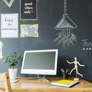 home office with chalk board wall