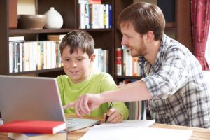 Man online tutoring a young boy