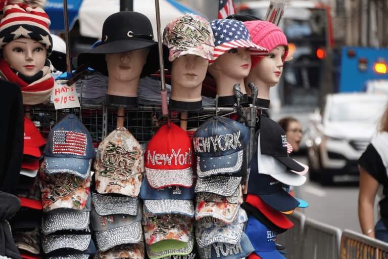 A stall with many different hats to represent the different types of editors.