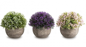 Three artificial plants with flowers