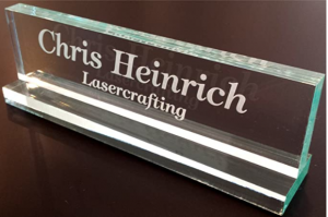 Picture of an engraved glass nameplate on a desk