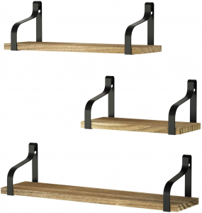 Three floating shelves on a wall