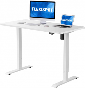 White electrical height-adjustable desk with two monitors.
