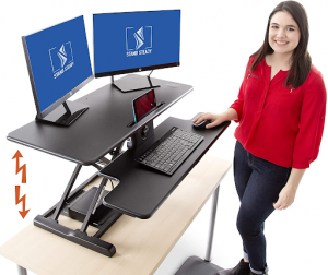 Electrical standing desk converter with two monitors