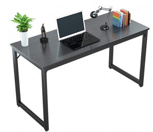 Sleek black desk with laptop, lamp and books