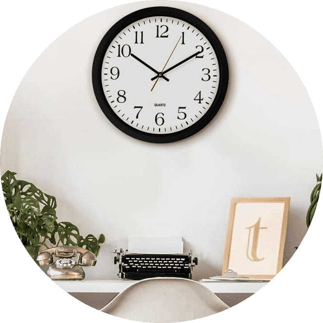 Analog wall clock on a wall with black hands