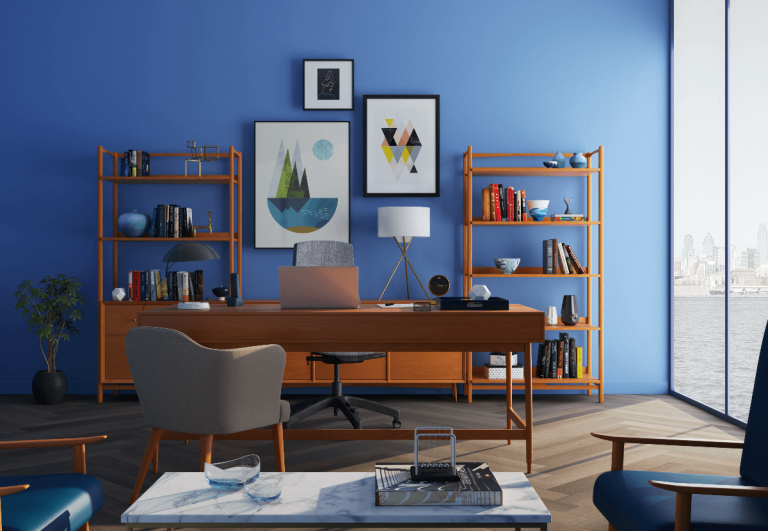 Blue home office with wooden desk and chairs
