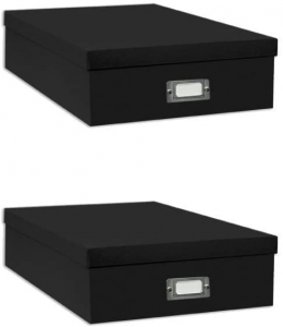 Two black storage boxes with white labels