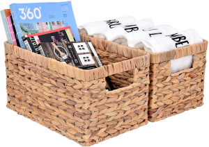 Wicker baskets with magazines and towels