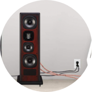Speaker with cables lying around