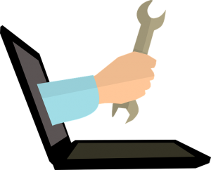 Icon of a hand coming out of a laptop holding a spanner