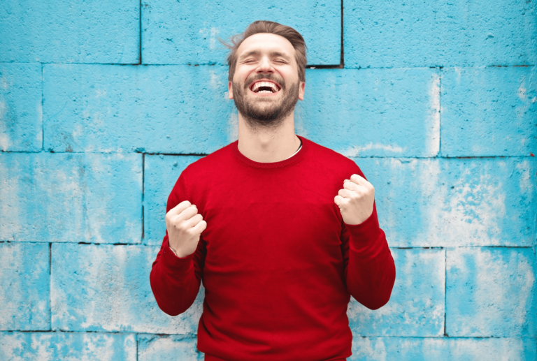 Happy man in a red shirt after great remote customer service