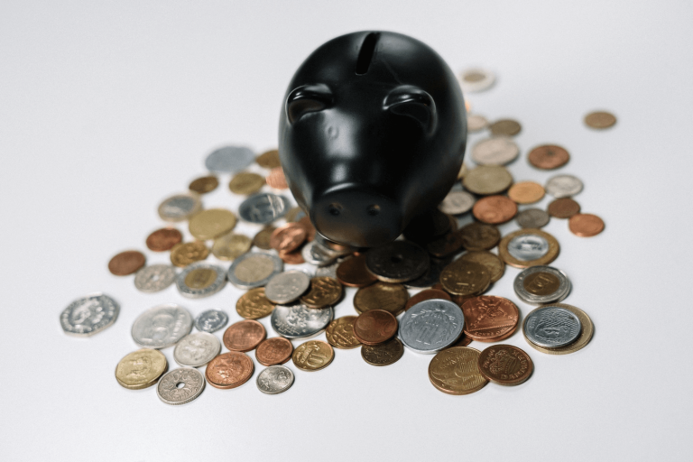 A piggy bank with coins to represent managing pay-per-click budgets