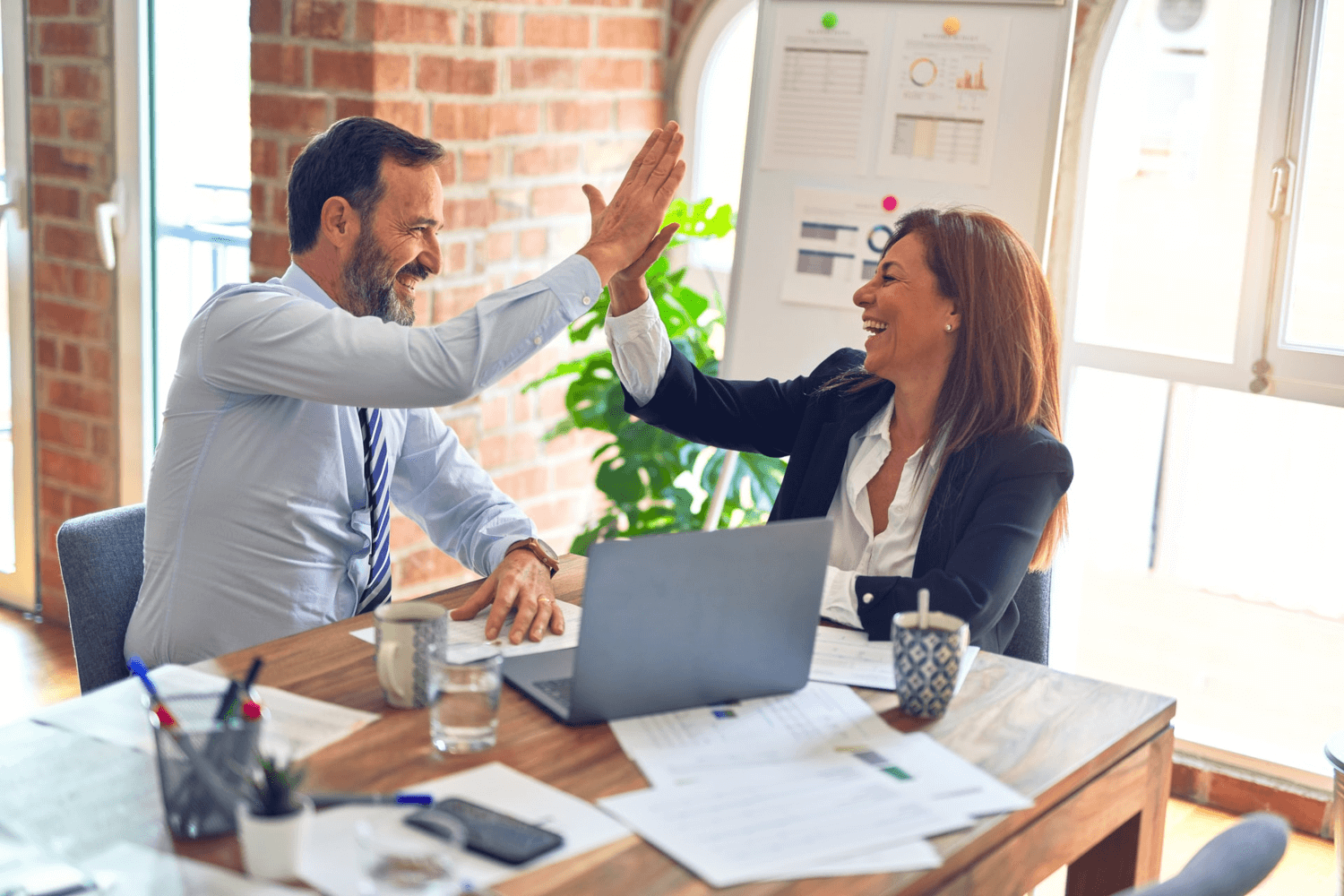 Small business owners high-fiving