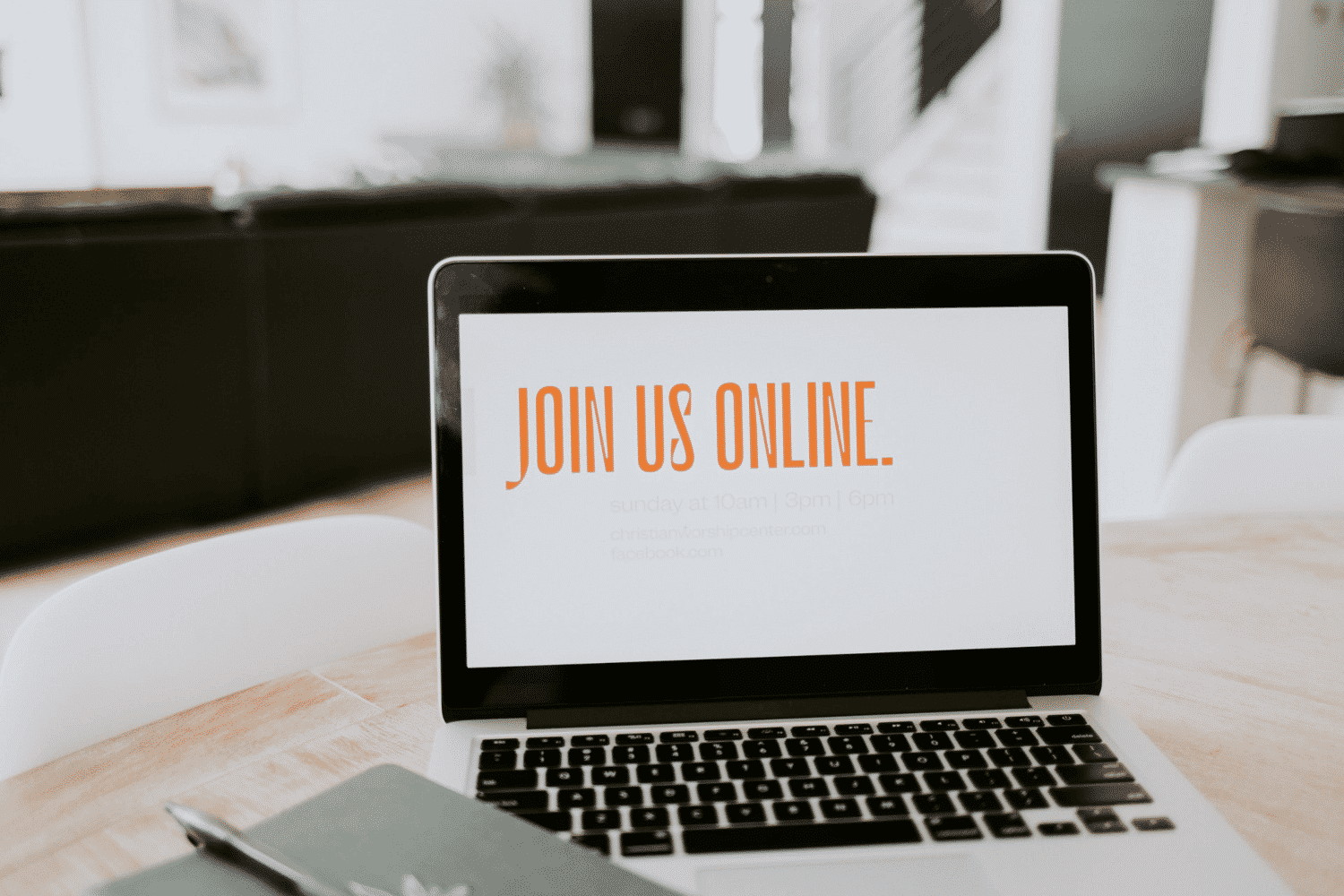 Laptop with Join Us Online on the screen