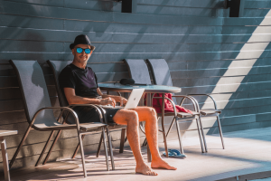Is blogging still relevant? Yes, this man sitting by the pool is a blogger