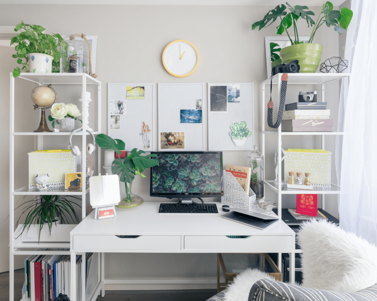 A home office with artwork
