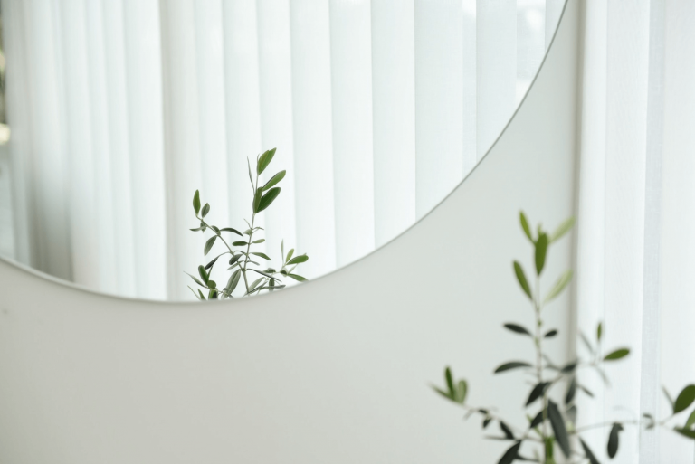Use mirrors to bring light into your home office
