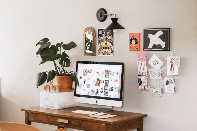 A home office with a plant