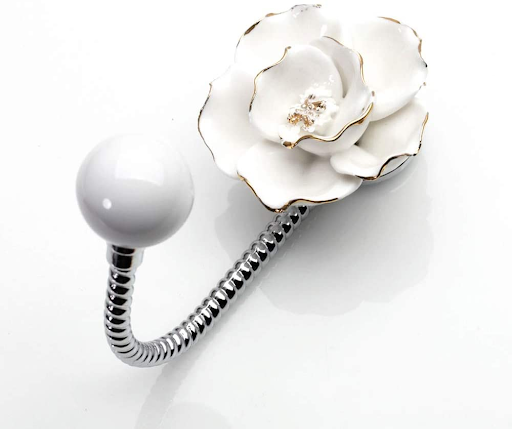Decorative hooks with a white flower